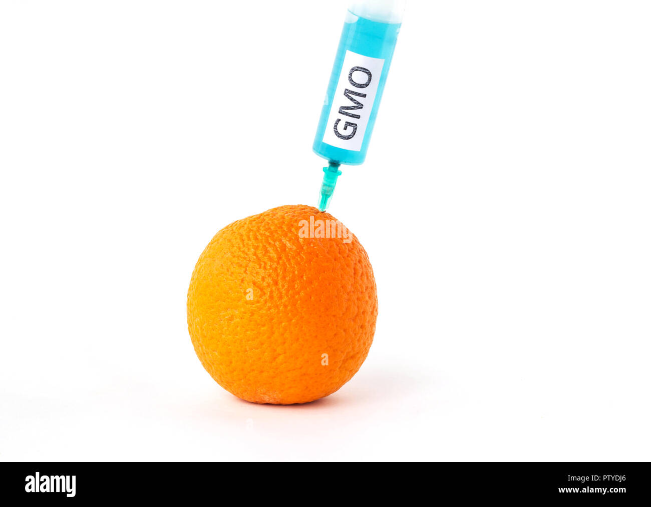 Orange on a white background in which enter gmo and nitrates, close-up, genetically modified organism, orange - Stock Image