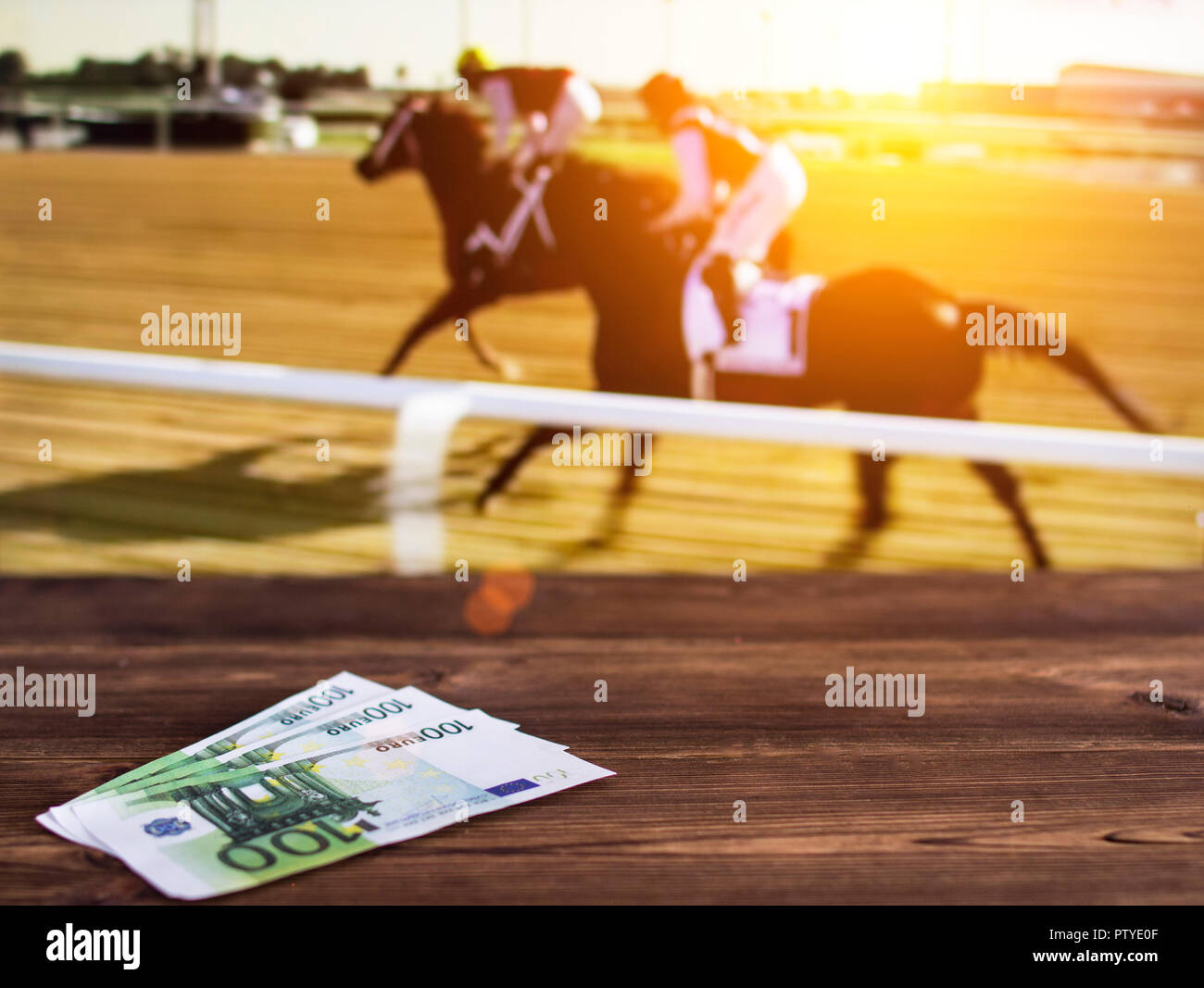 Euro money on the background of a TV on which show jumps on horses, sports betting, races, euro - Stock Image