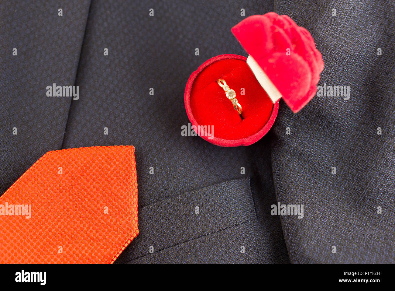 Offer hands and heart, ring tie suit - Stock Image