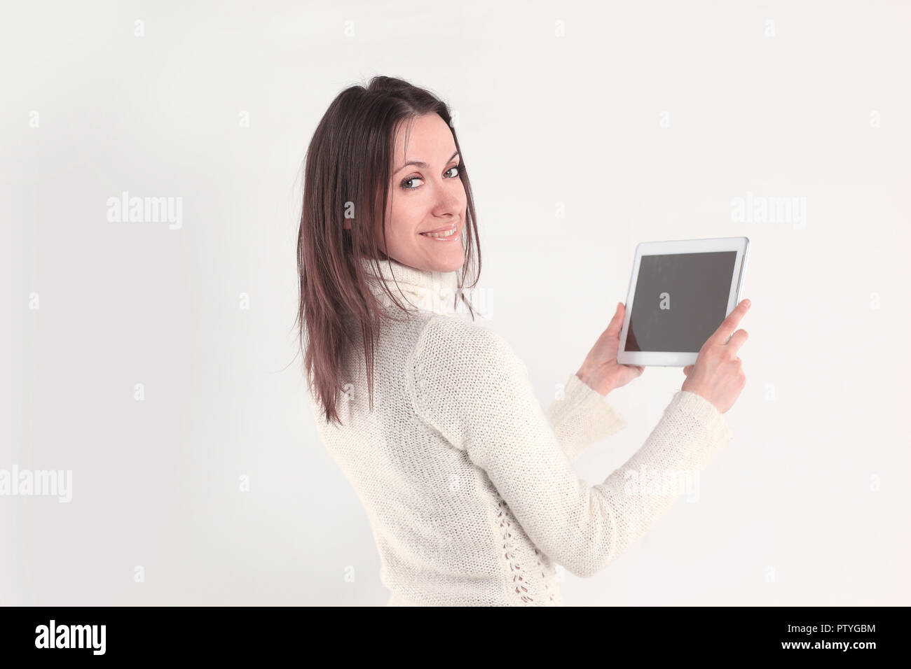 rear view. creative woman with digital tablet looking at camera.photo with copy space - Stock Image