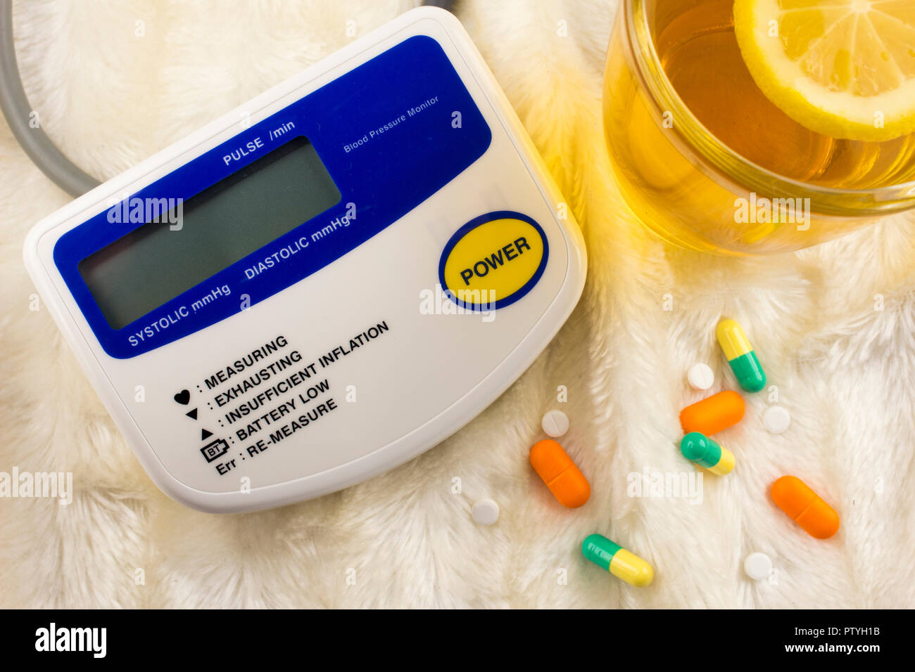 Apparatus for measuring pressure, tablets tea with lemon - Stock Image