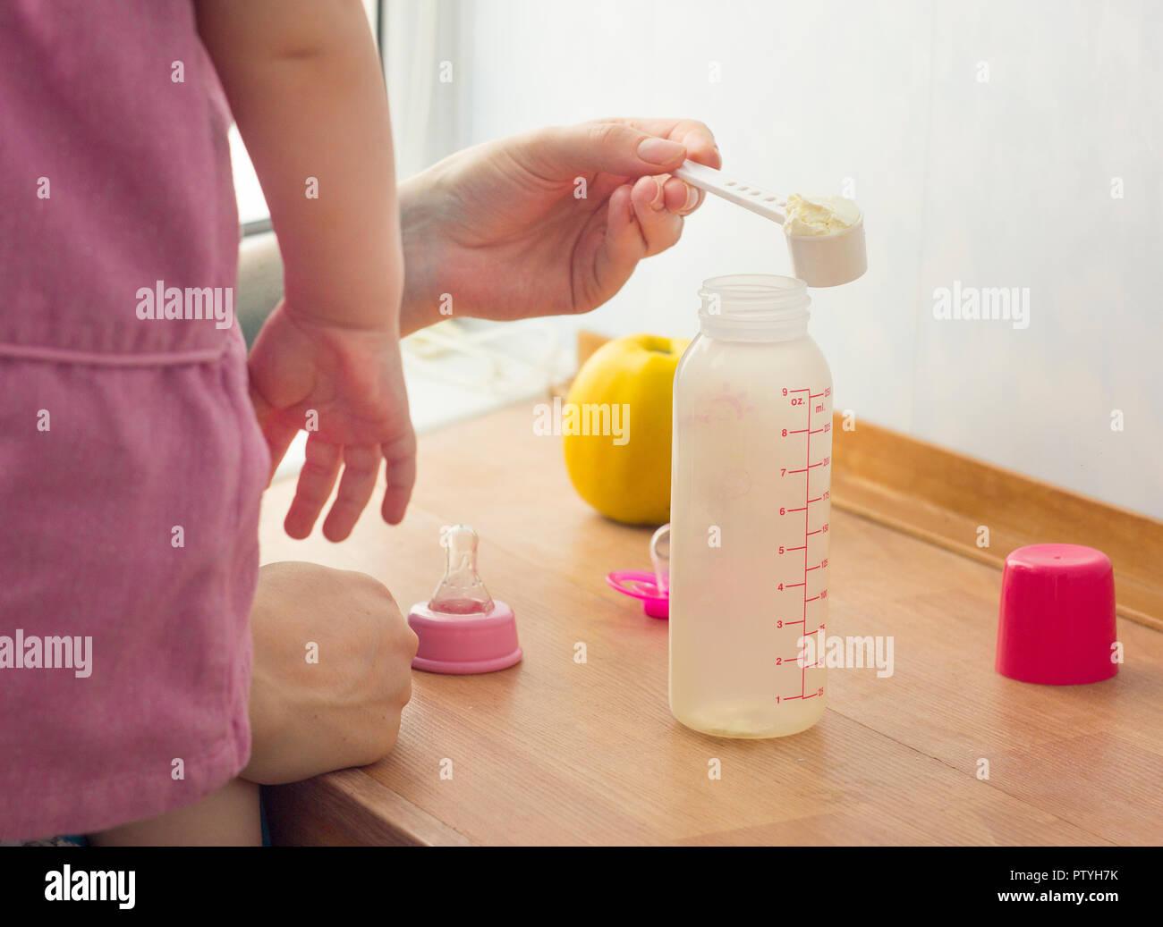 Preparation of infant formula - Stock Image