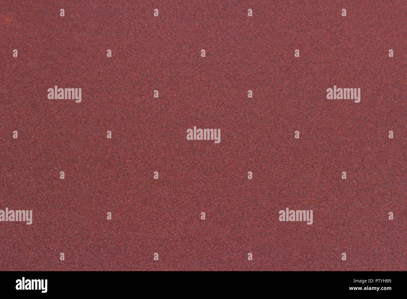 Texture of red sandpaper - Stock Image