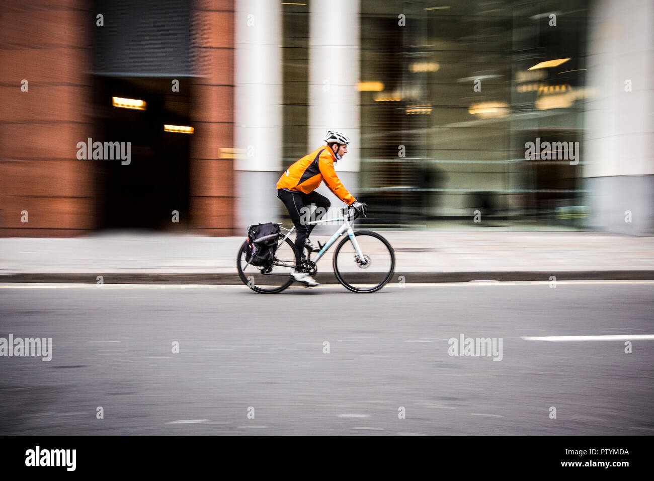 Motion blur of a cyclist speeding in central London. England, UK. - Stock Image