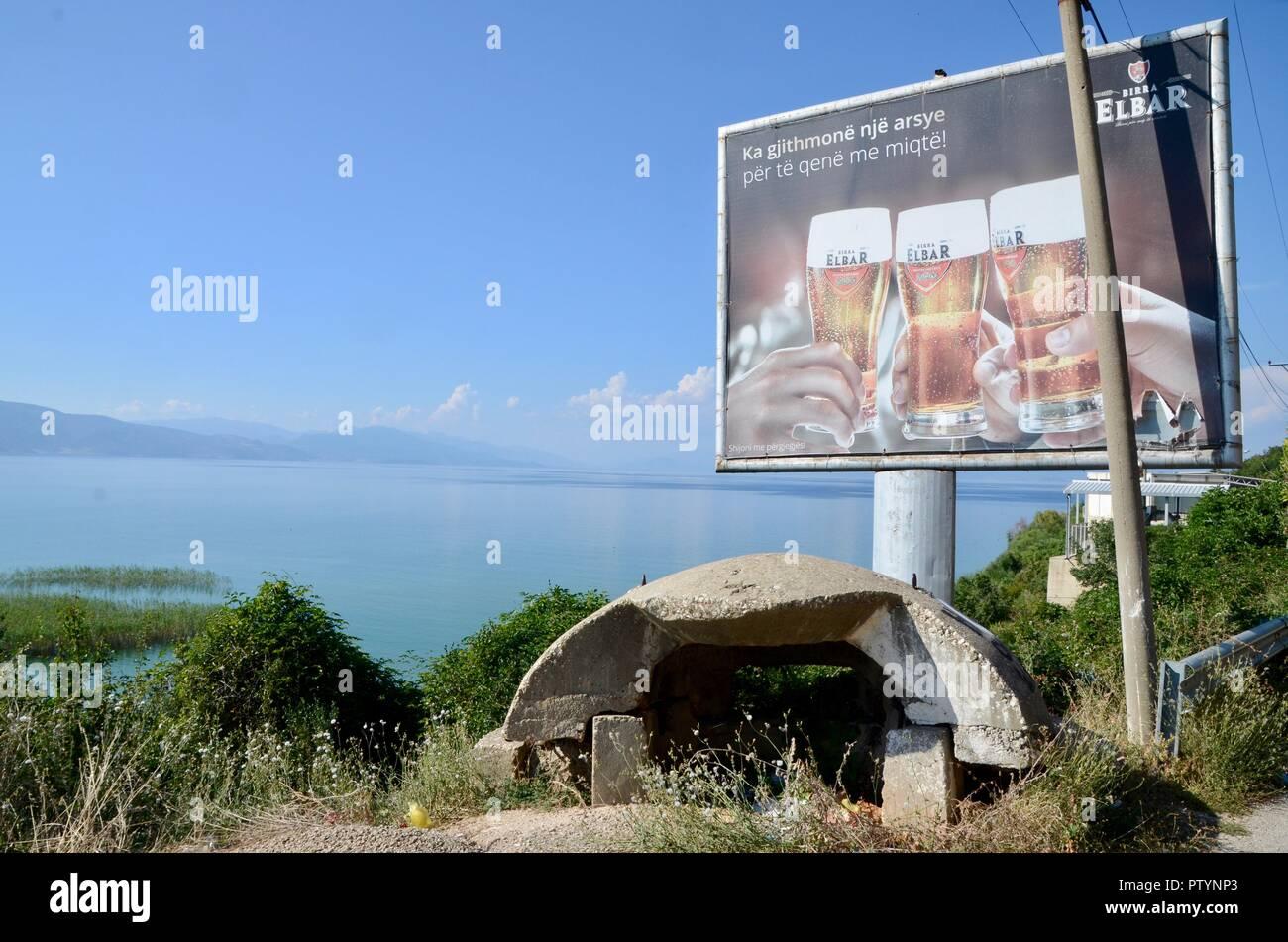 beer advert billboard and concrete bunker near Pogradec albania - Stock Image