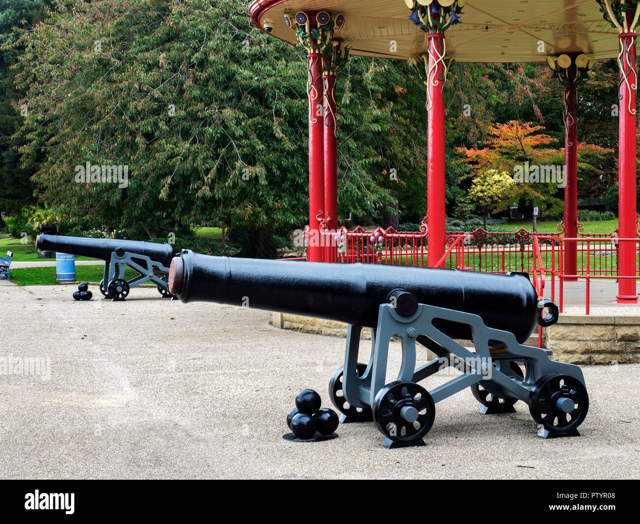 Restored cannons at the bandstand in Roberts Park Saltaire West Yorkshire England - Stock Image