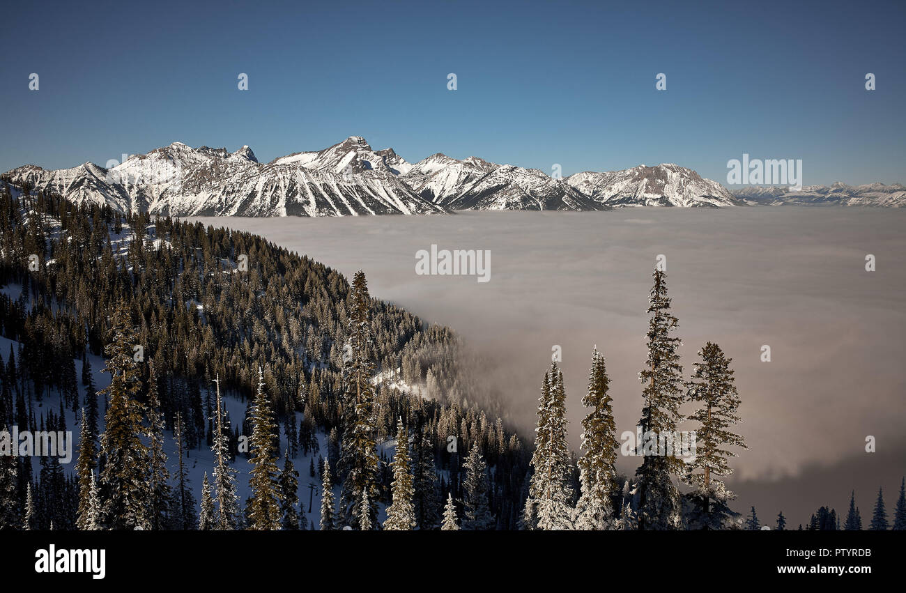 Shot from Fernie Alpine Resort facing north east with a view of Mount Fernie, Three Sisters and Mount Hosmer. - Stock Image