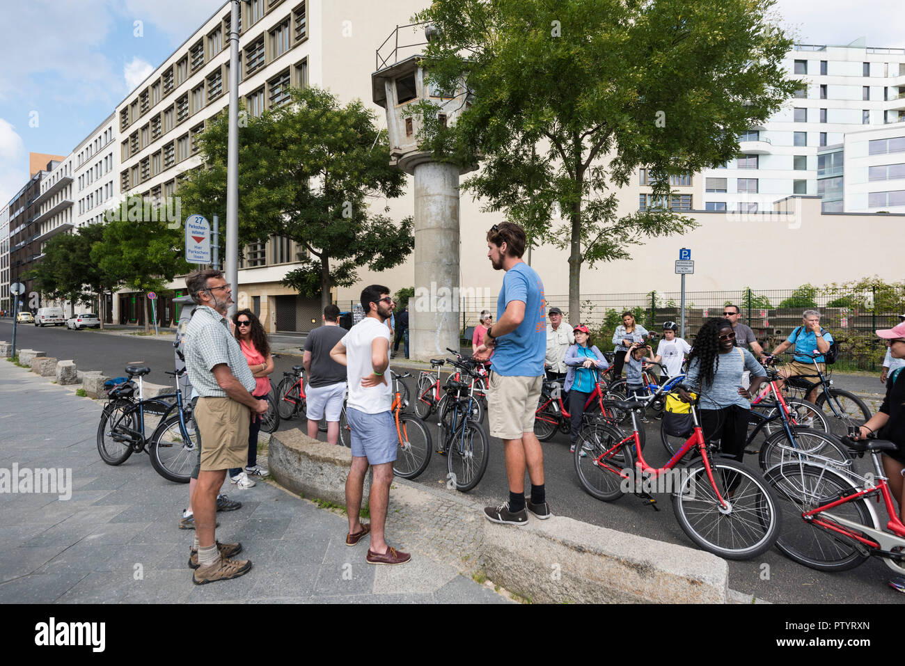 Berlin. Germany. Tourists visit the former border watchtower on Erna Berger Straße near Potsdamer Platz. - Stock Image