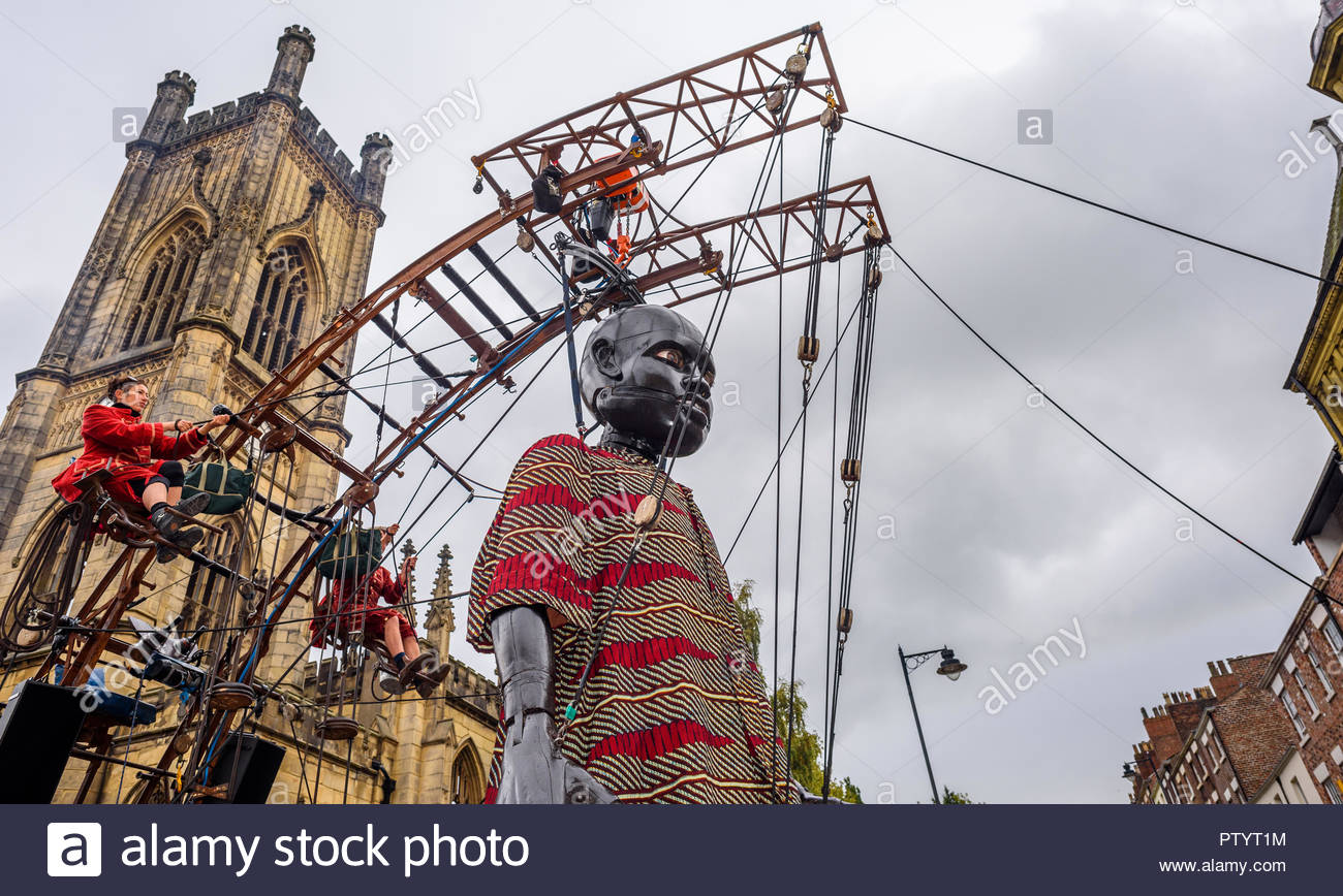 Liverpool 5th October 2018. Puppet created by Royal de Luxe.  A giant little boy puppet passes along Bold Street, Liverpool. - Stock Image