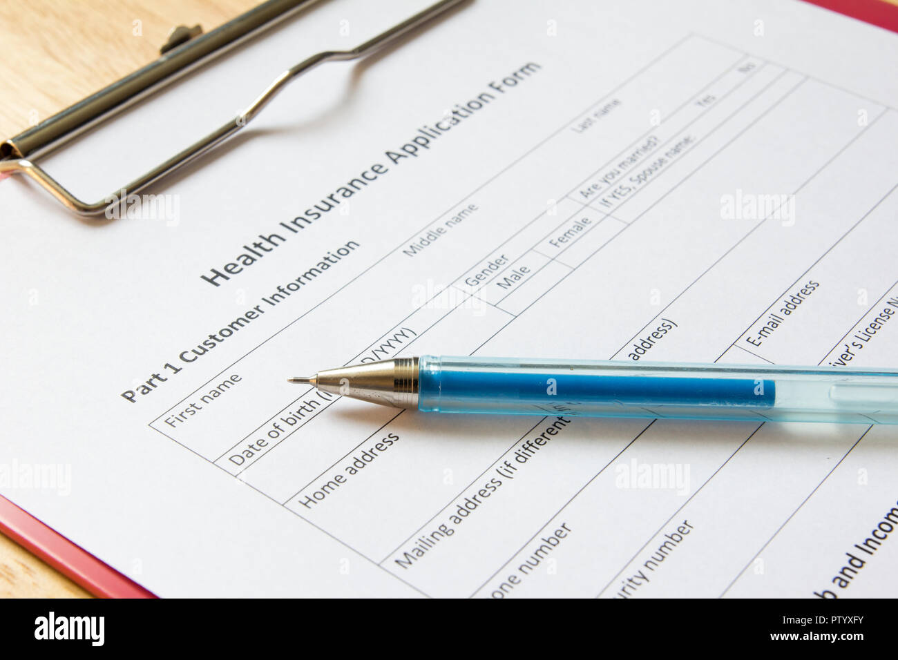 blank health insurance application form with pen wait for fill data