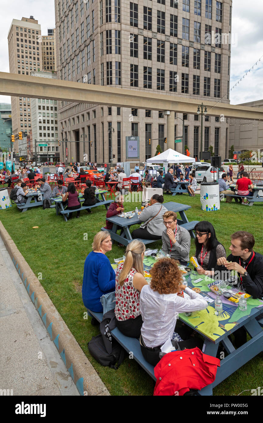 Detroit, Michigan - People eat lunch on a warm autumn day in Spirit Plaza. The plaza was created by closing Woodward Avenue, a main downtown street. Stock Photo