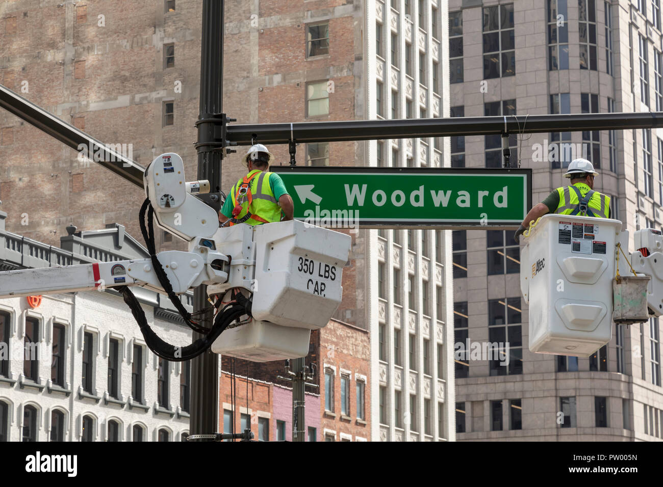 Detroit Michigan Workers Prepare To String Wire For Traffic Light Wiring Signals At A Downtown Intersection