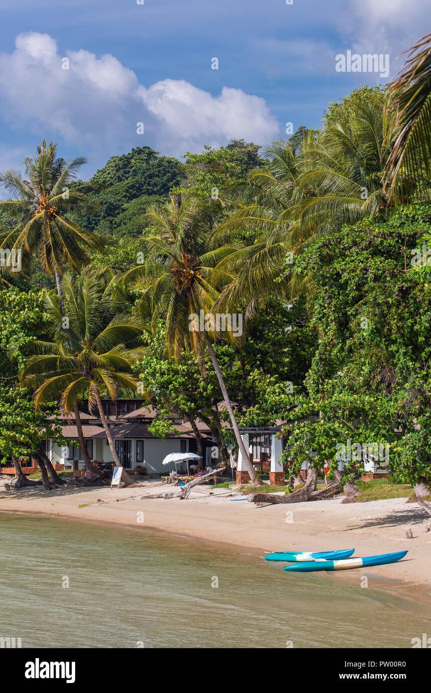 Kayaks on the tropical beach on Koh Kood island in Thailand - Stock Image
