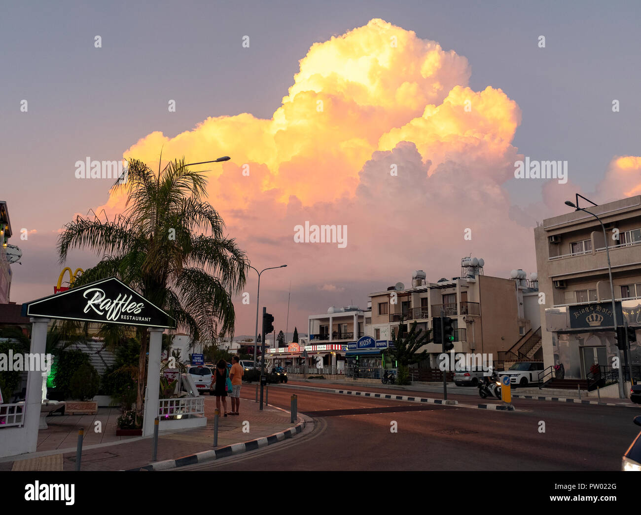 Clouds illuminated by the setting sun above Paphos, Cyprus. - Stock Image