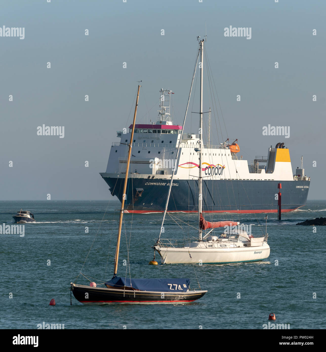 Commodore Goodwill a cross channel commercial ship entering Portsmouth Harbour, England UK. - Stock Image