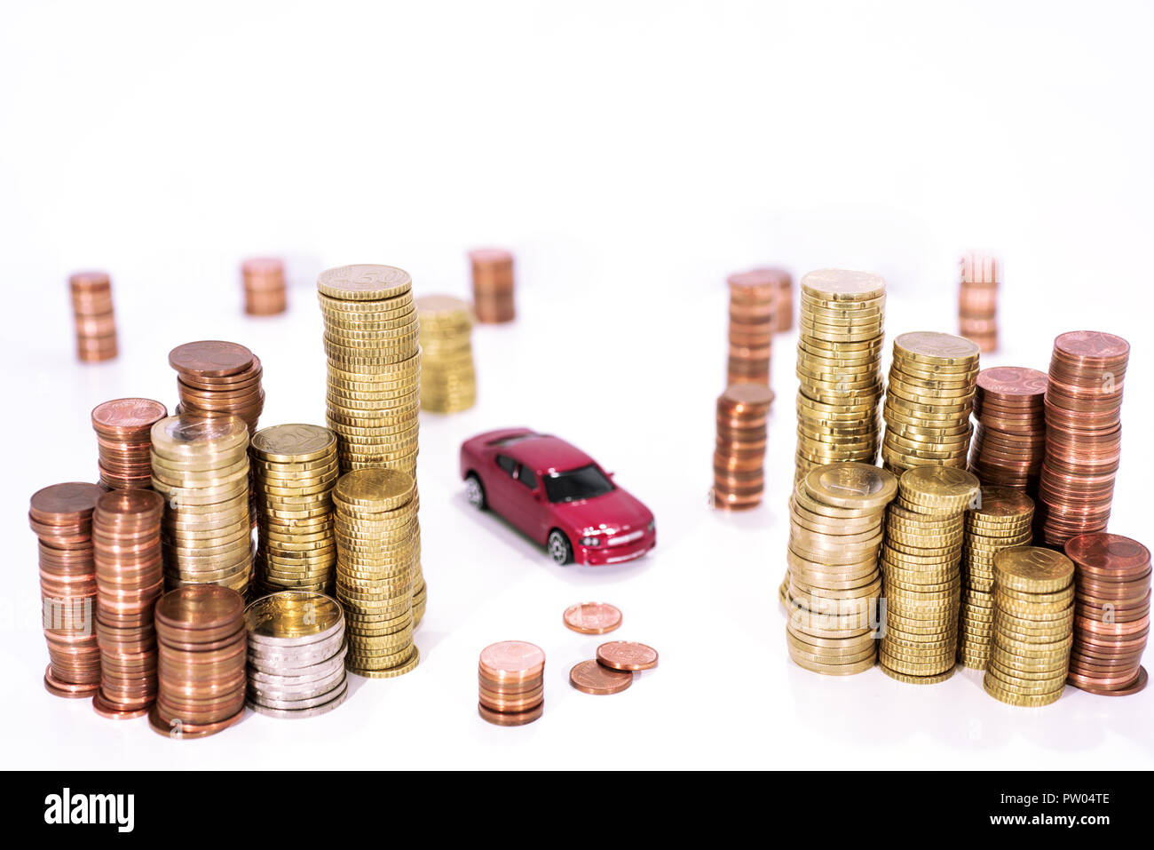 Abstract photo of car price rising. Car model isolated on white background with a lot of euro coins. - Stock Image