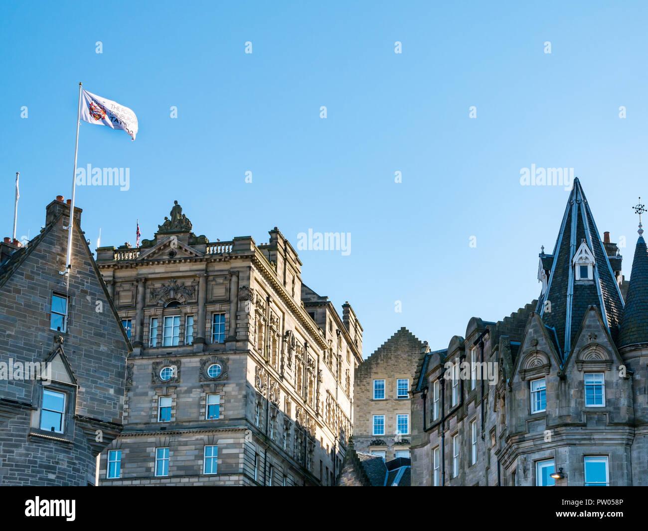 Ornate rooftops of Edinburgh Old Town buildings, Cockburn Street, Edinburgh, Scotland, UK with Military Tattoo flag flying Stock Photo