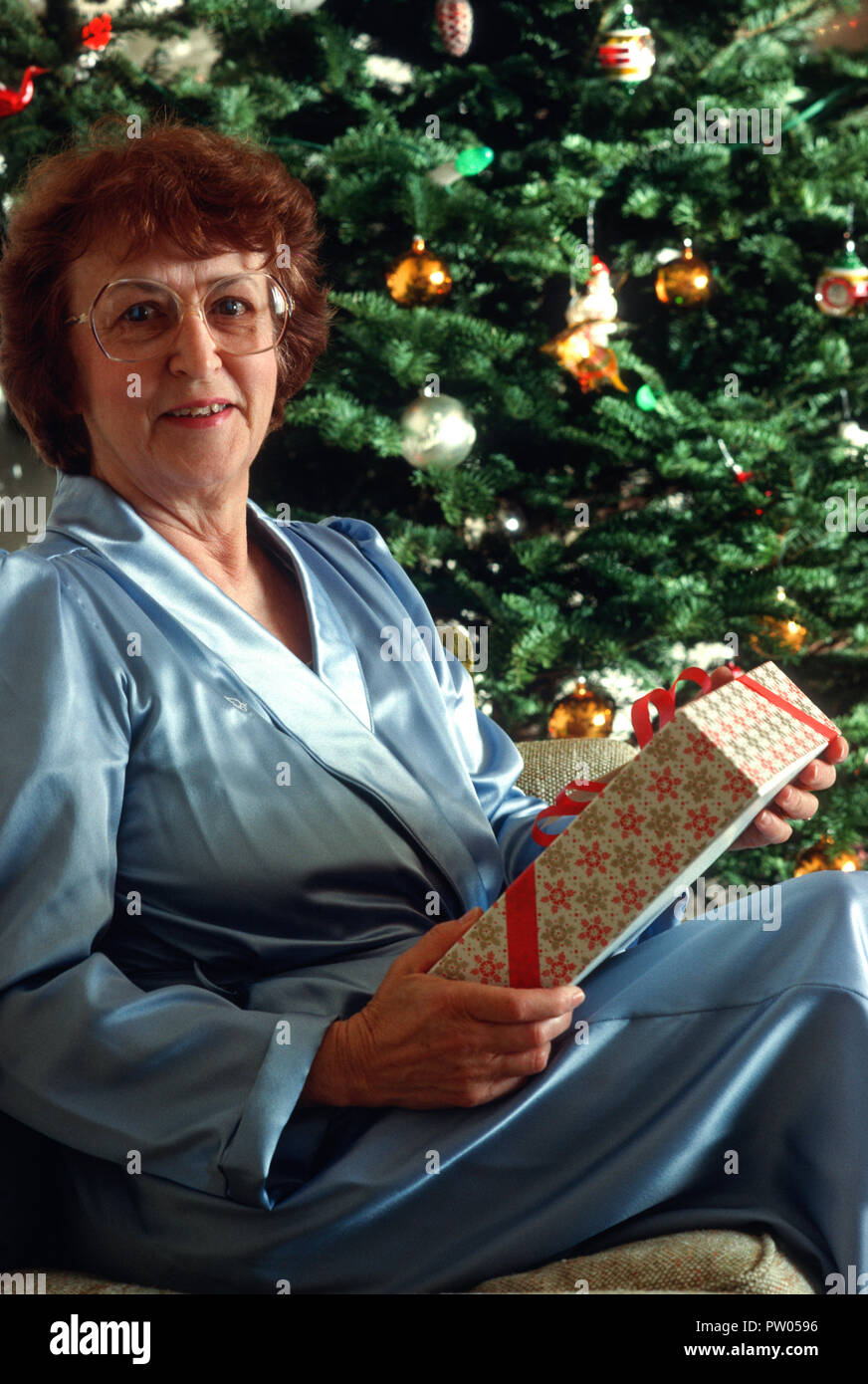 smiling senior woman with christmas gift usa
