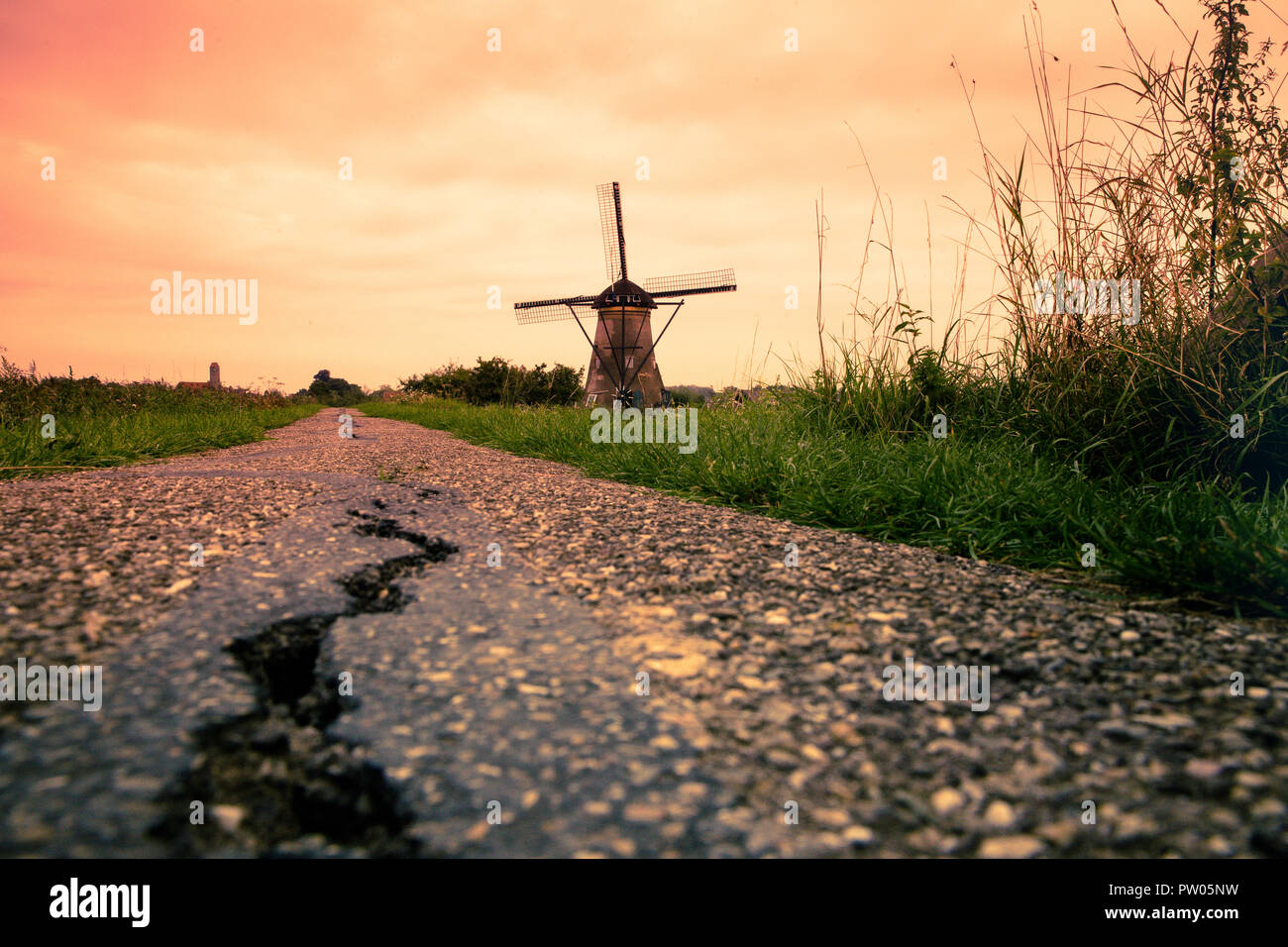 Beautiful Dutch windmills at sunset from Holland Stock Photo