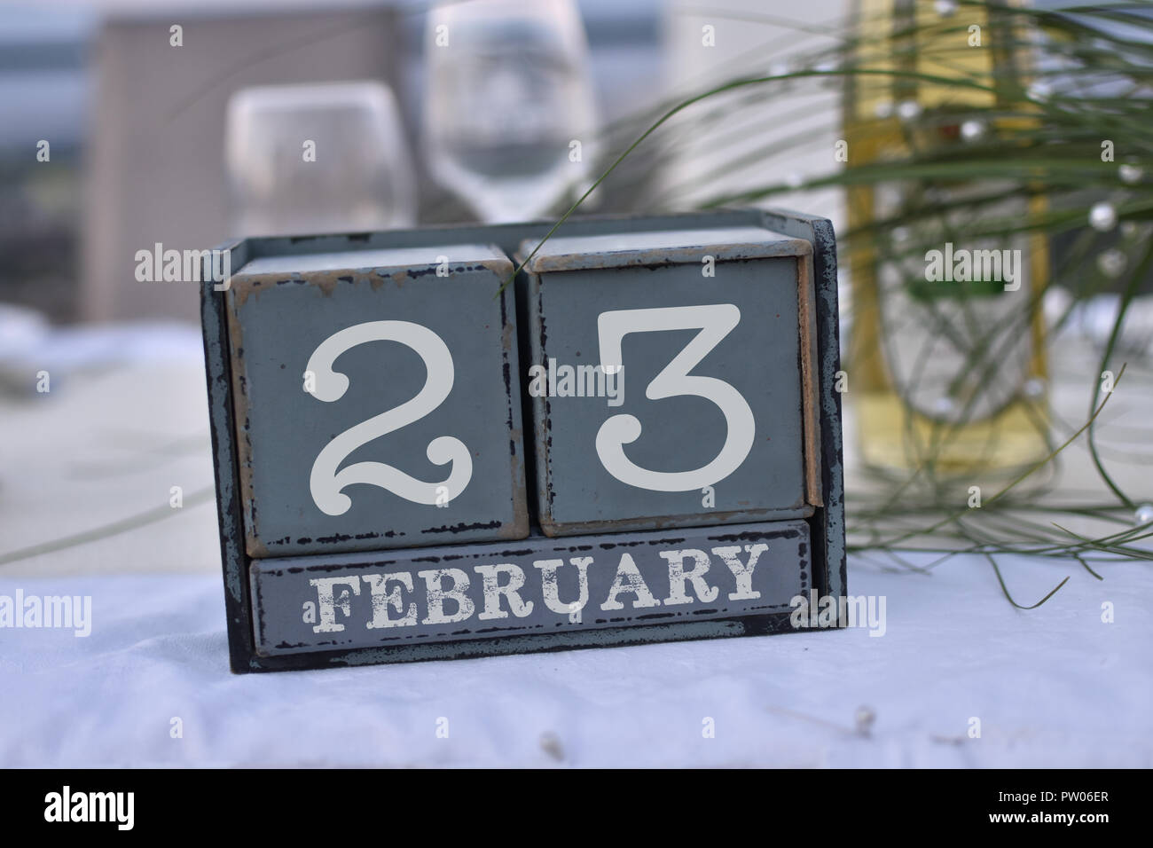 Wood blocks in box with date, day and month 23 February. Wooden blocks calendar Stock Photo