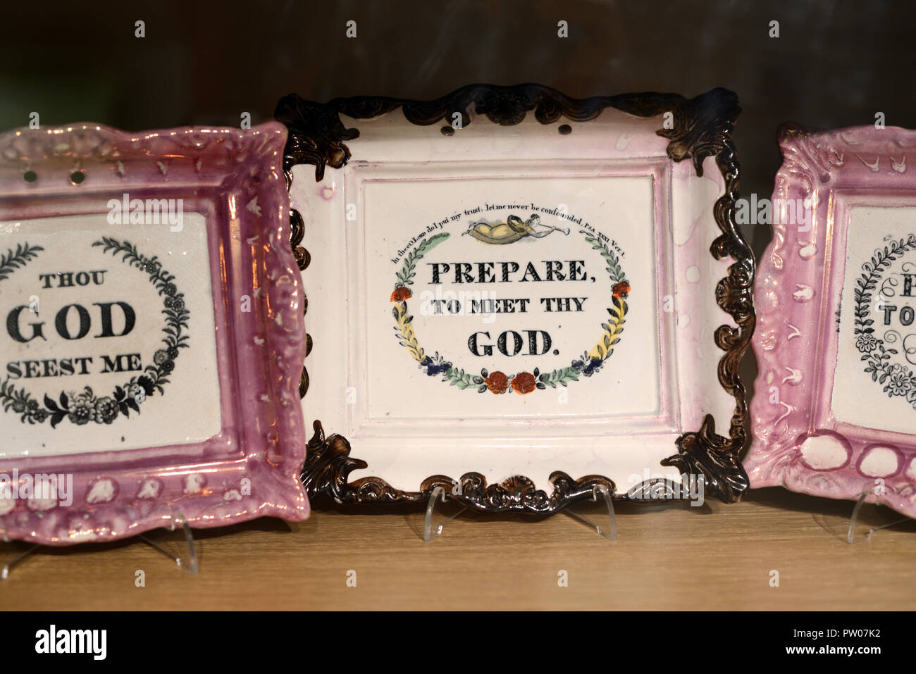 Display of Religious Ceramic Trays or Porcelain Tray with Slogan Prepare to Meet Thy God. Early c20th English Knick Knack or Bric-à-brac - Stock Image