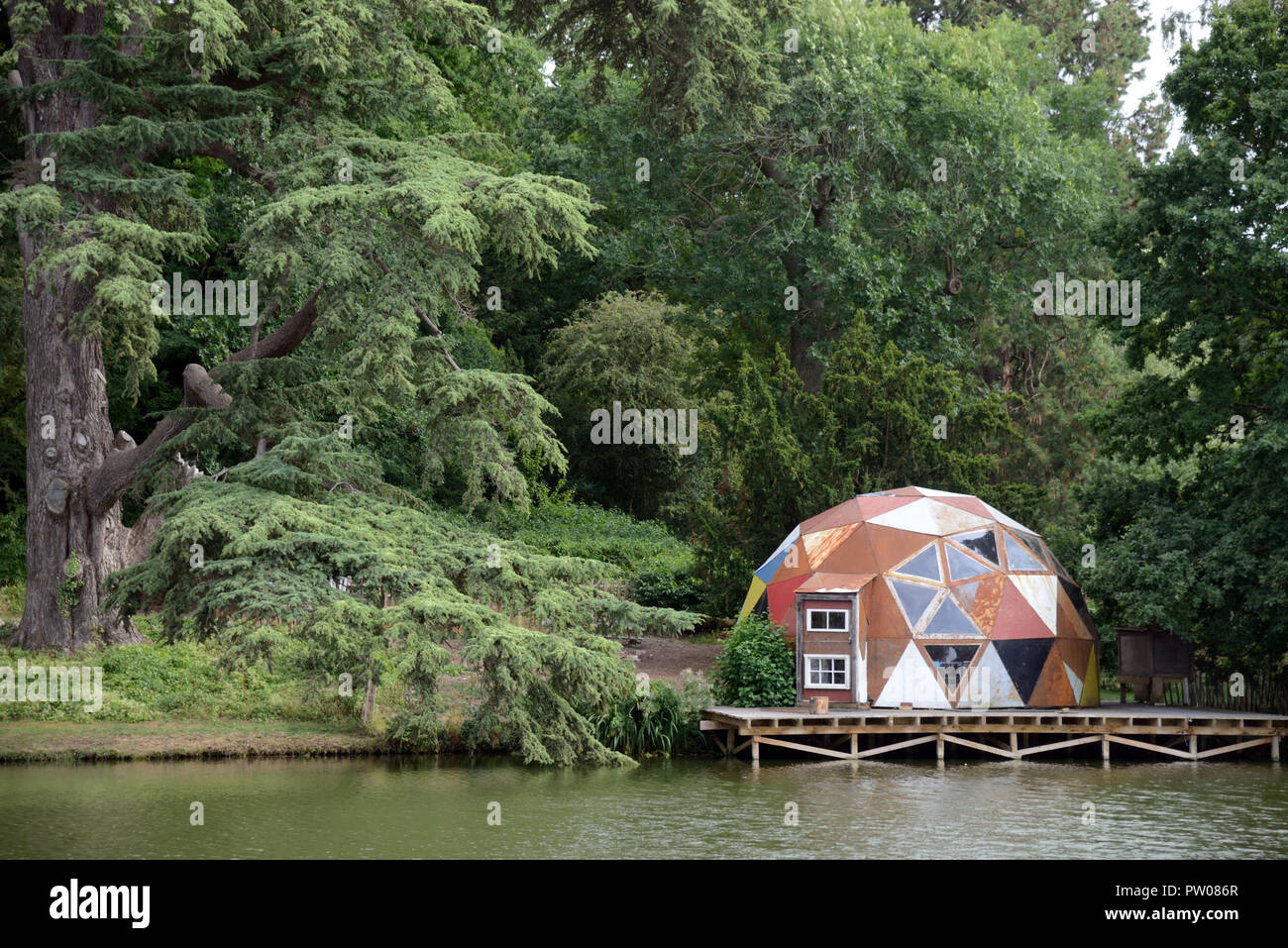 Geodesic Dome Home on Edge of Lake and Forest or in Woods at Compton Verney Warwickshire England - Stock Image