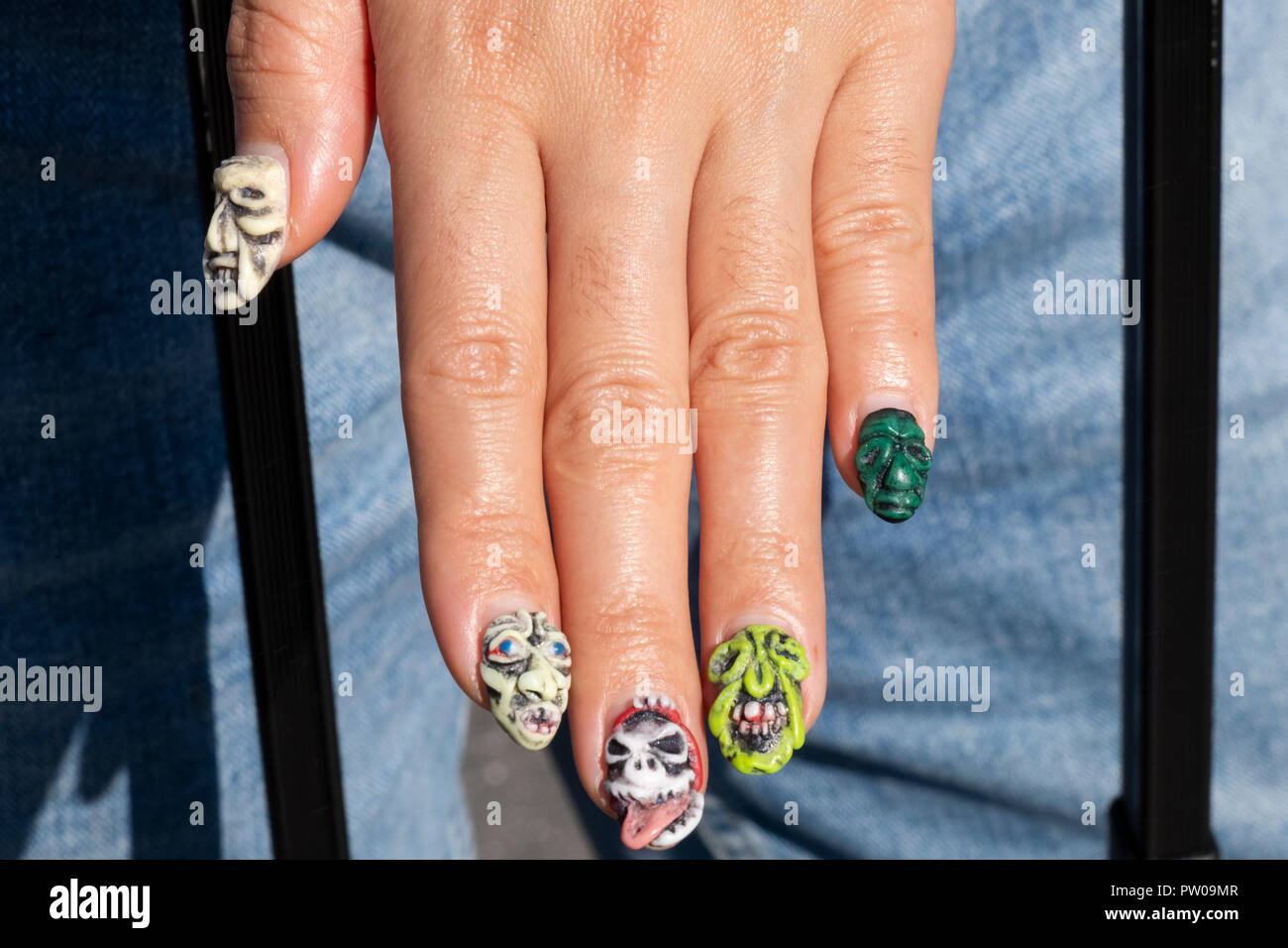 3D NAILS. Nail Artist and stylist Elina Ogawa designed these three dimensional nails and shows then on her left hand. In Manhattan, New York City. - Stock Image