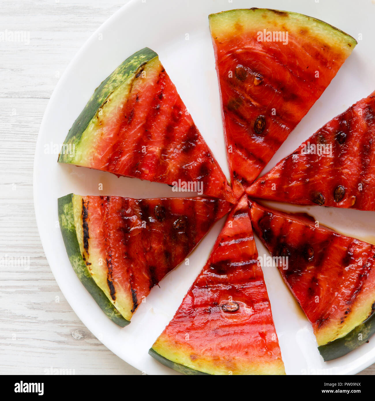 How Many Slices In Round Table Pizza.Many Slices Of Grilled Watermelon On A White Round Plate On White