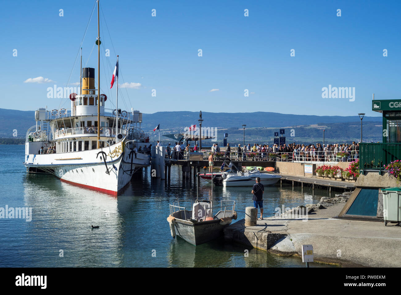 Swiss historic Belle Epoque paddle steamboat Savoie in the old port at Yvoire along Lake Geneva / lac Léman, Haute-Savoie, France - Stock Image