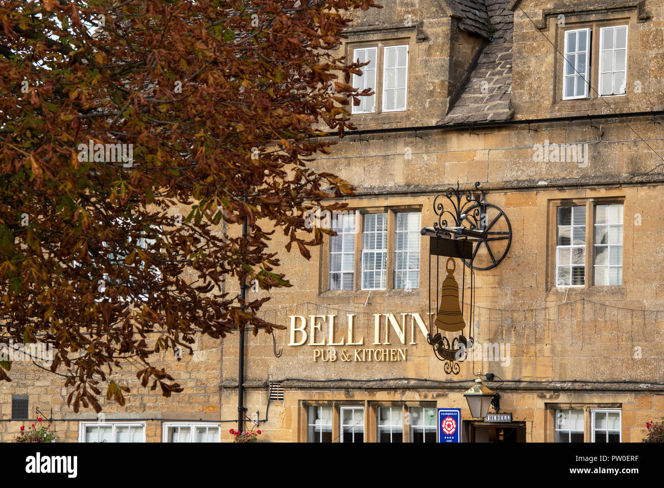 Bell inn in the  early morning autumn sunlight. Willersey, Cotswolds, Gloucestershire, England Stock Photo
