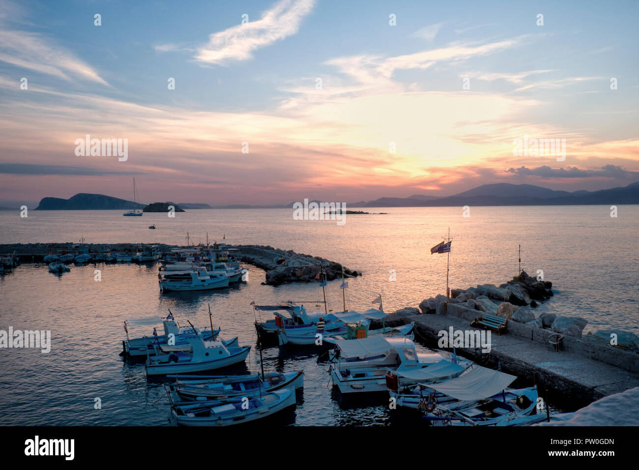 Sunset over Kaminia beach, Hydra (Ydhra) in the greek Argo-Saronic islands. - Stock Image