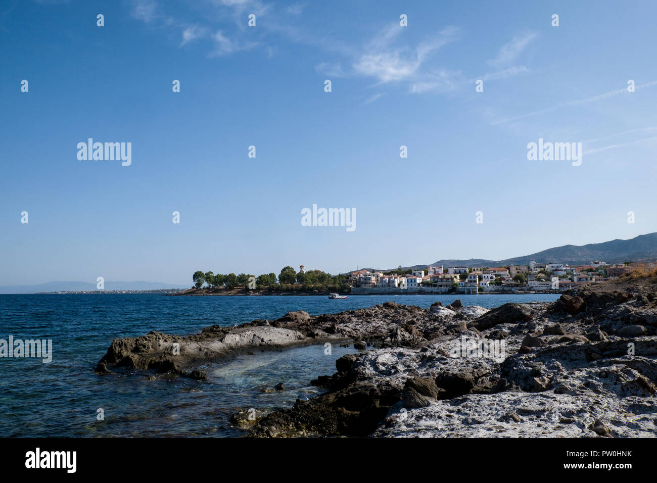 Looking back across the bay to Perdika on the greek island of Aegina.  The view is from coast path on the peninsula opposite the harbour. - Stock Image