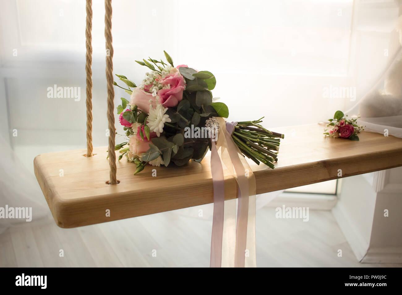 Wedding Flowers Bouquet On Indoor Swing With Window Wedding