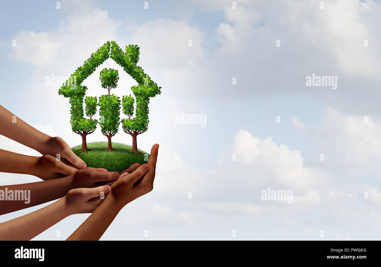 Social rental housing and community growth concept as a group of diverse hands holding trees shaped as a home as an eco friendly. Stock Photo