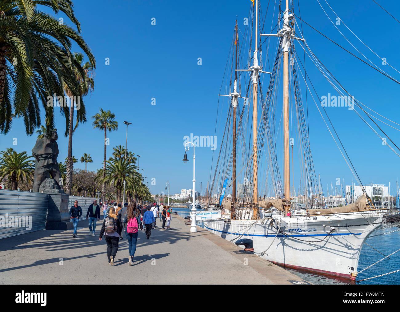 Seafront promenade in the Port Vell (Old Port), Moll de Bosch i Alsina, Barcelona, Spain - Stock Image