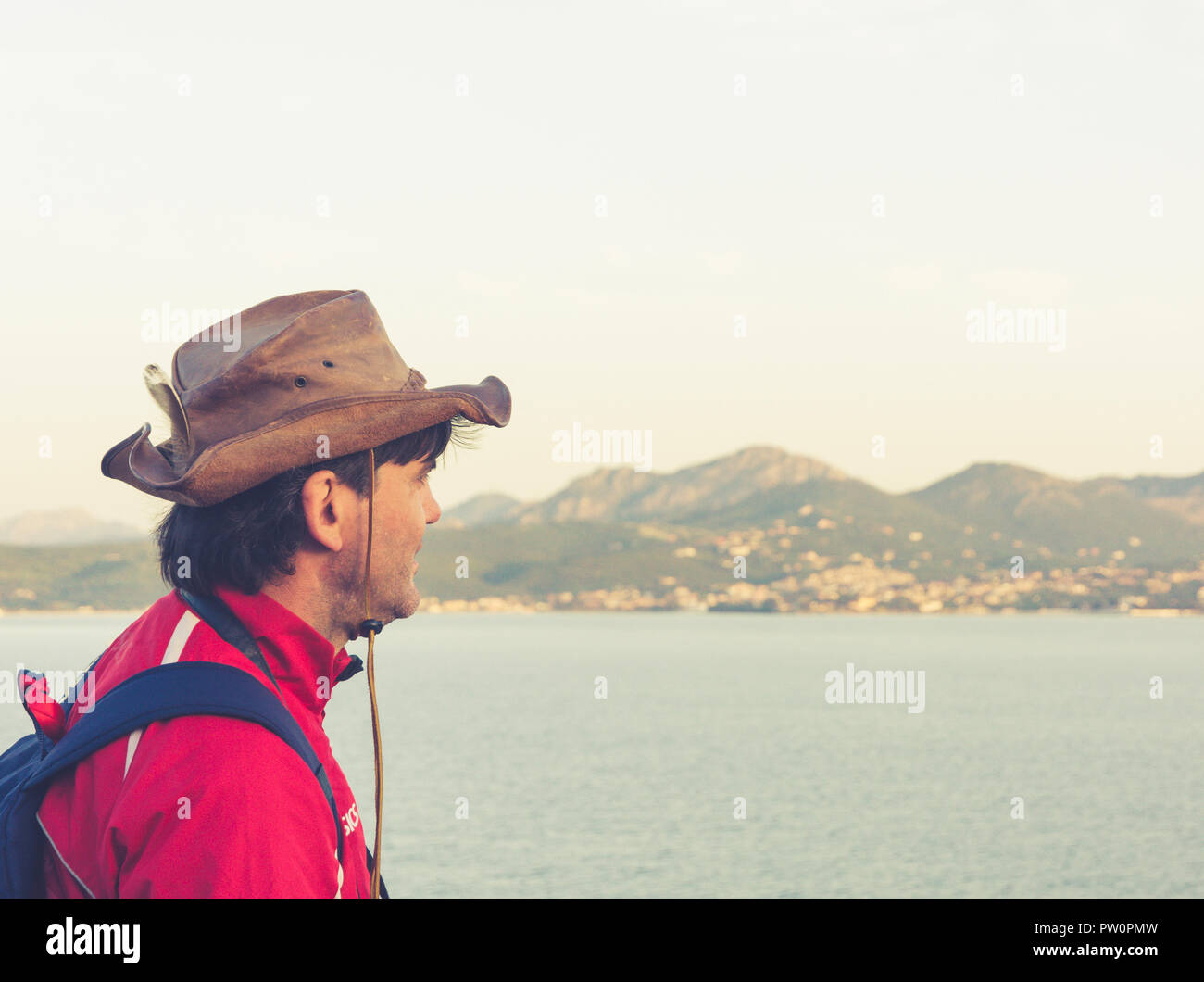 OLBIA, Sardinia, Italy - april 29, 2018: tourist on cruise ship looks at the city of Olbia, Island of Sardinia, Italy - Stock Image