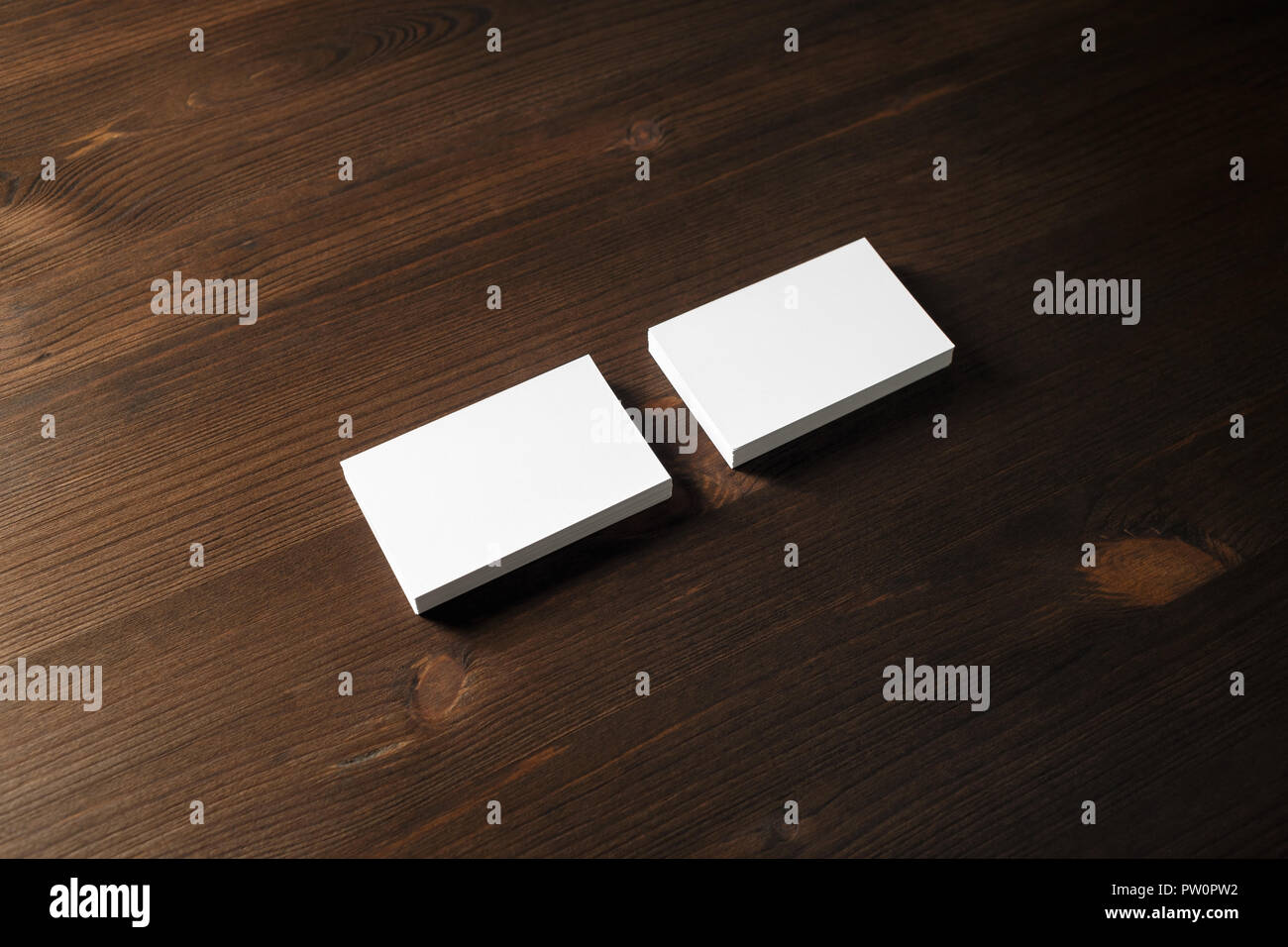 Two Blank Business Cards Stacks On Wooden Background Template For