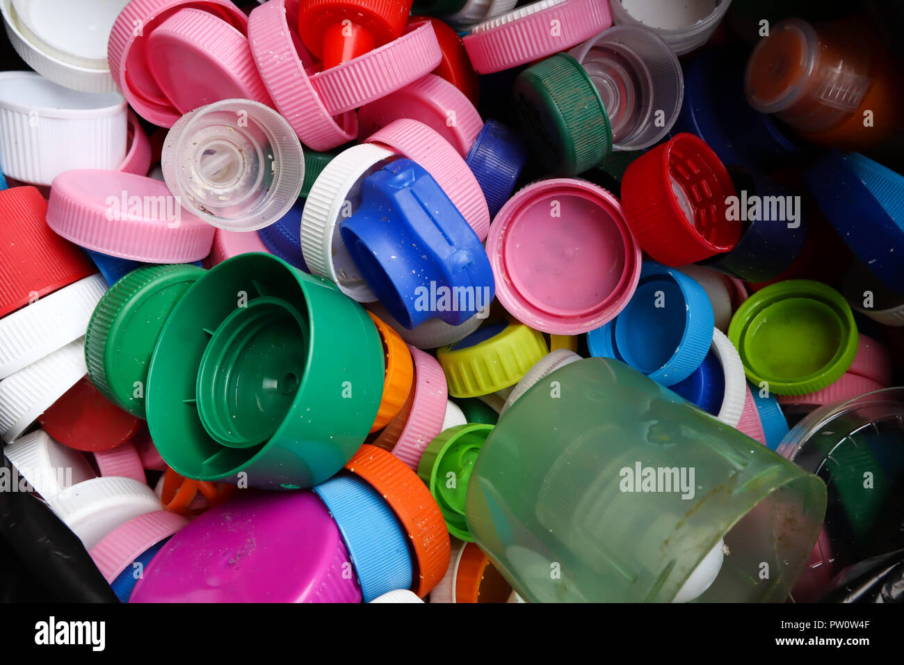 group of multicolored bottle caps ready for recycling top view close up - Stock Image