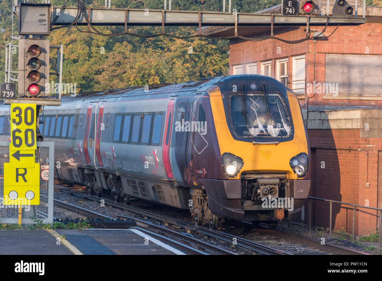 cross country train and emergency speed restriction signs at southampton central railway station - Stock Image