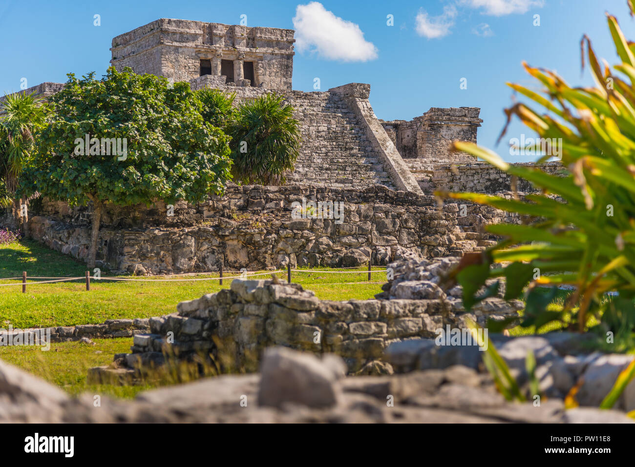 Mayan ruins restored in Tulum, Mexico. Ancient buildings from the maya empire hundreds years ago - Stock Image