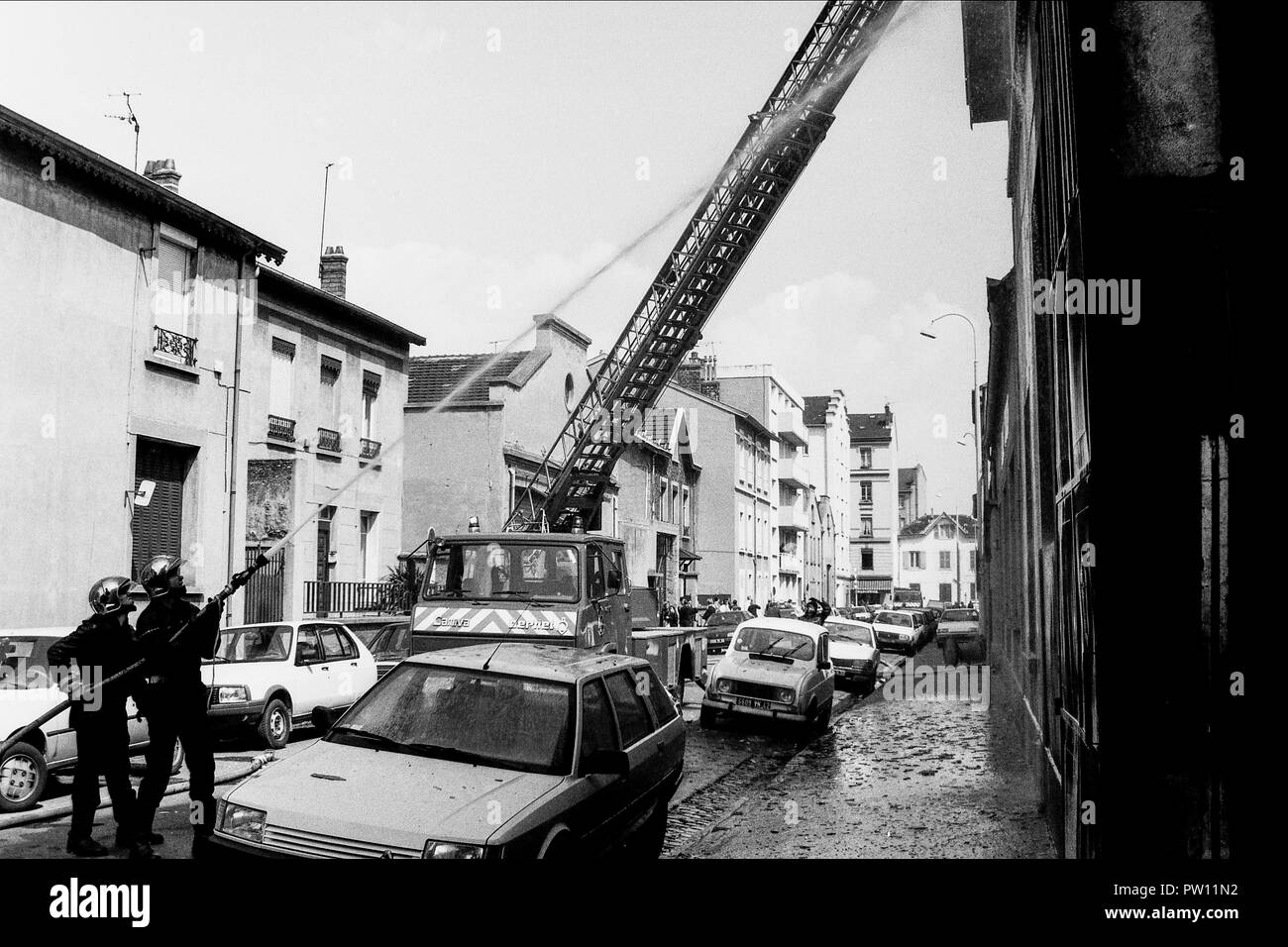 Archives 90ies: Firefighters at work in a burning factory