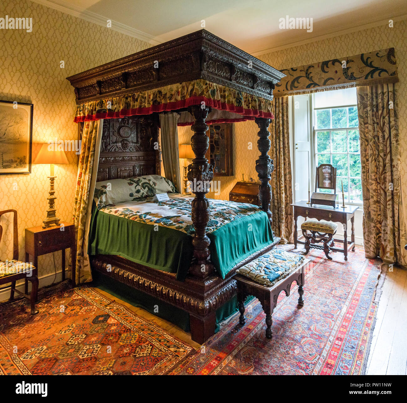 A large canopy bed decorated by carved pillars in one of the rooms inside of Crathes Castle Aberdeenshire Scotland & A large canopy bed decorated by carved pillars in one of the rooms ...