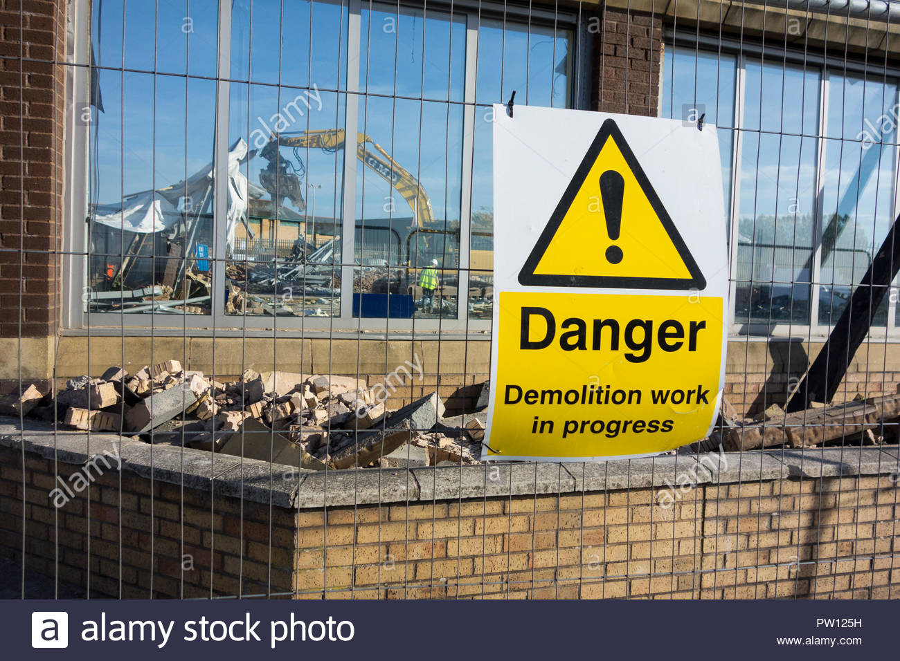 Danger, Demolition Work in Progress sign at the Demolition of an Aldi Store on Marine Road, Morecambe, following construction of a new store next door - Stock Image