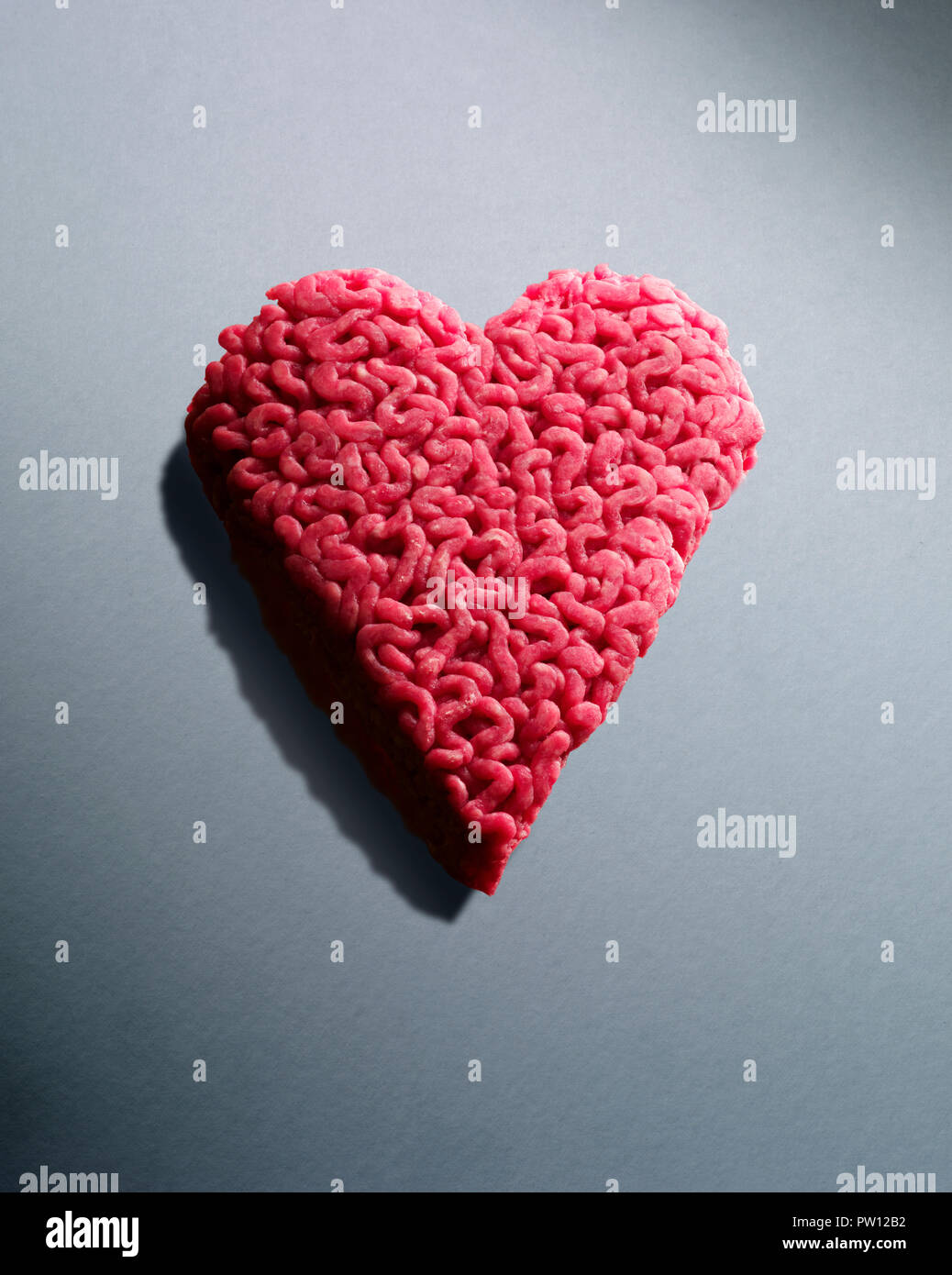 Concept An Heart made of Grounded Meat, Heartbreak, Grounded Heart, Heartache, Bad Relationship - Stock Image