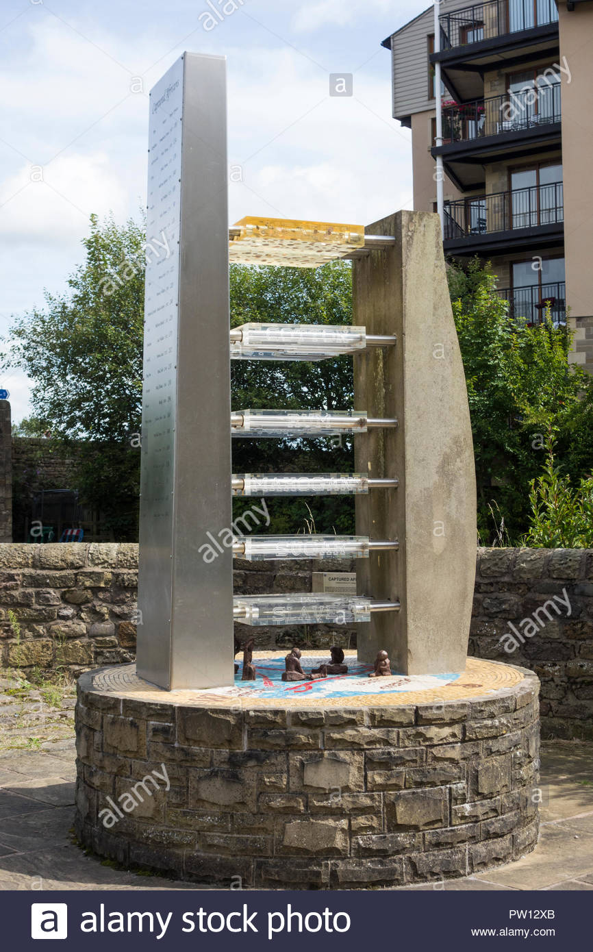 Captured African's Sculpture on St George's Quay, Lancaster, marking the City's maritime connection with the Slave Trade and the Slave Triangle. - Stock Image