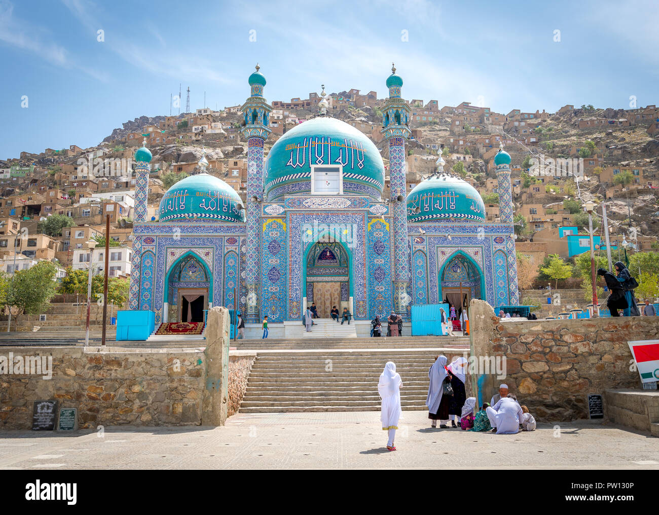 Muslim girl and women at mosque in Kabul Afghanistan city scape skyline, capital Kabul hills and mountains with houses and buildings - Stock Image
