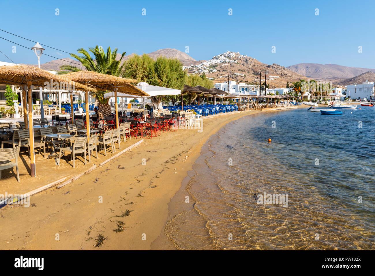 Sandy beach and greek taverns in Livadi town. Serifos island ...