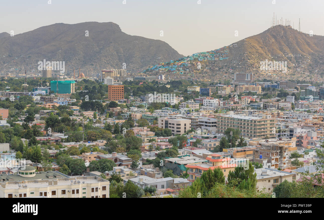 Kabul Afghanistan city scape skyline, capital Kabul hills and mountains with houses and buildings - Stock Image