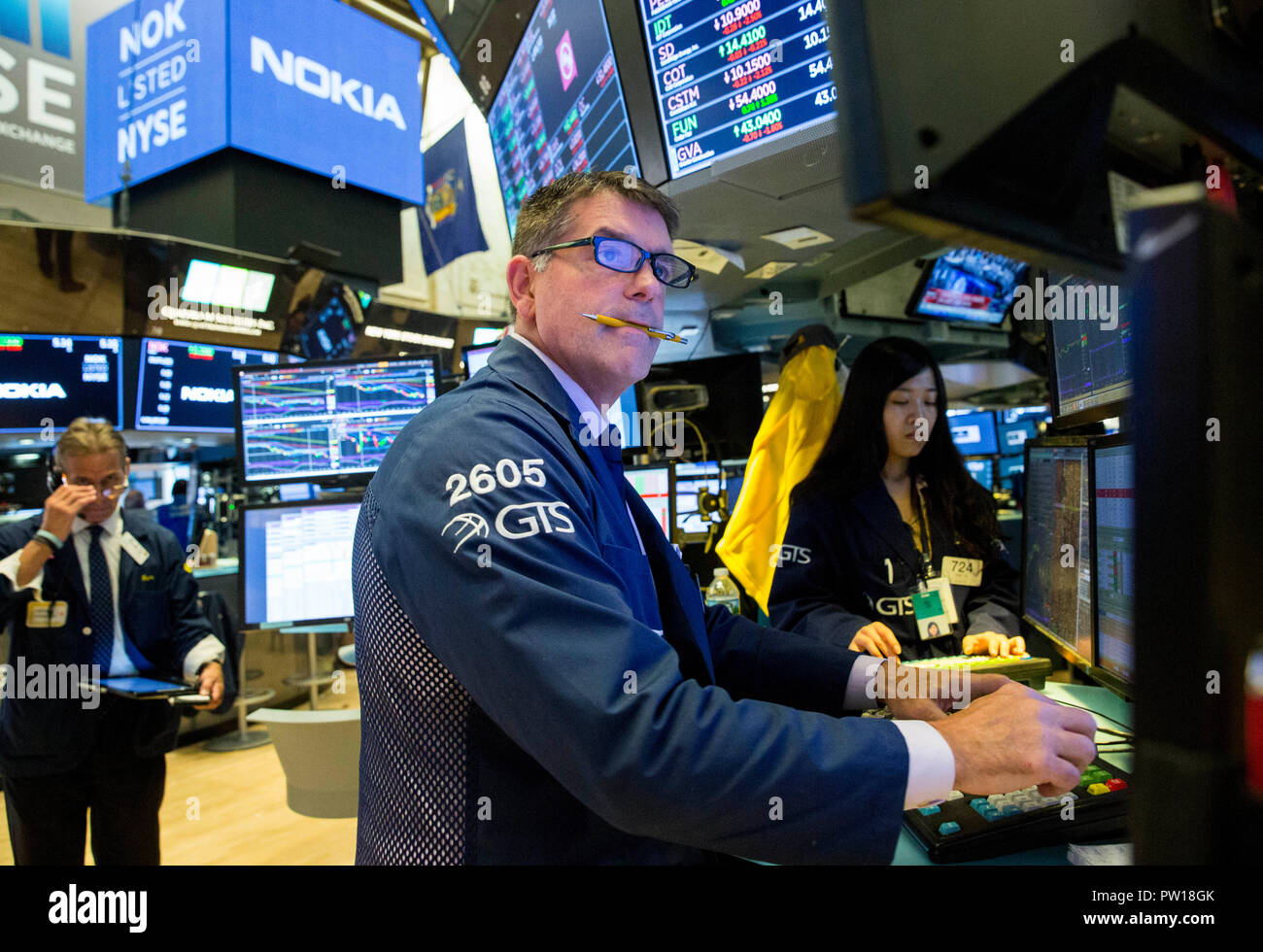 New York, USA  11th Oct, 2018  Traders work at the New York Stock