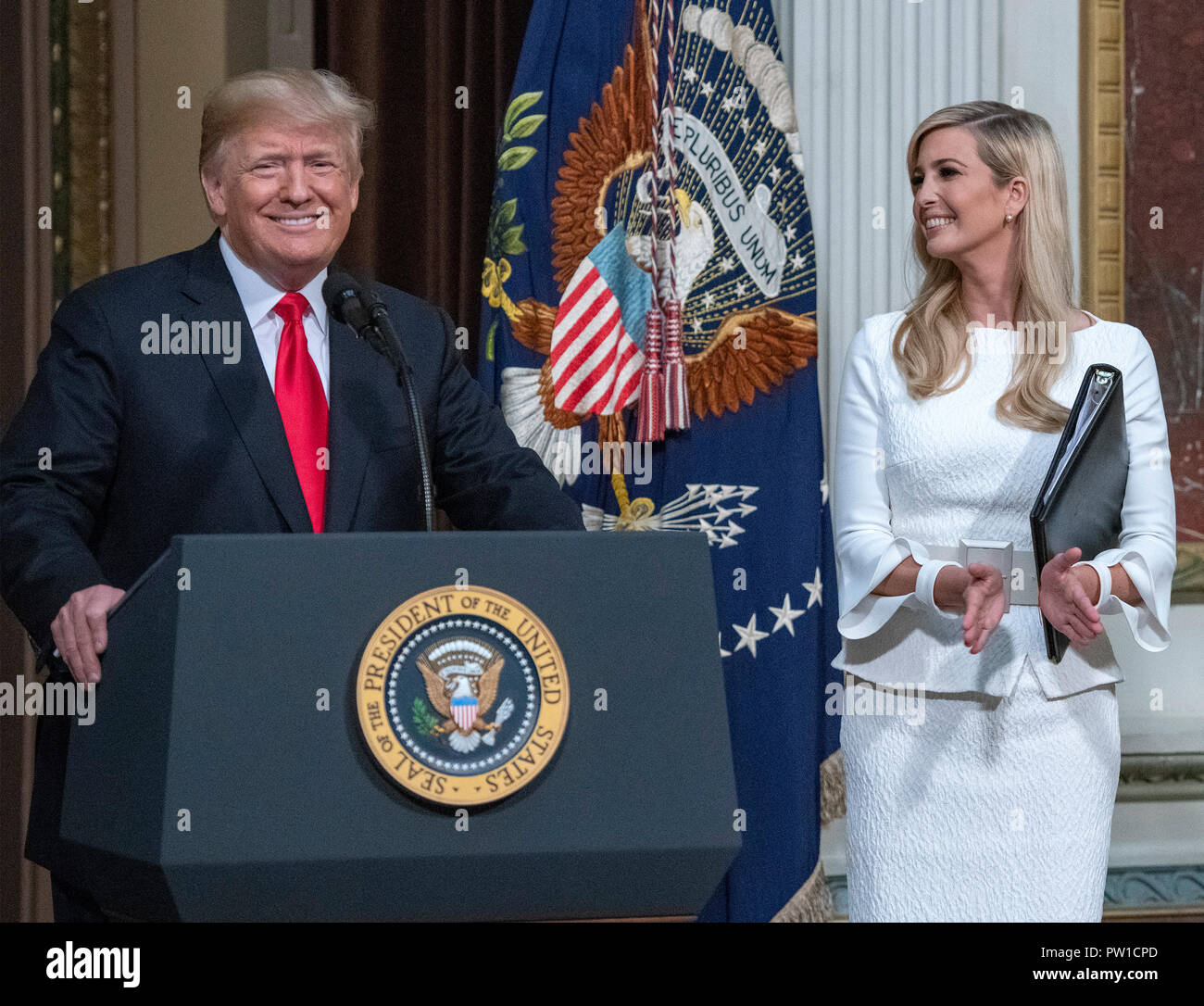 United States President Donald J. Trump arrives to make remarks at the Interagency Task Force to Monitor and Combat Trafficking in Persons annual meeting in the Indian Treaty Room of the White House in Washington, DC on Thursday, October 11, 2018. At right is First Daughter and Advisor to the President Ivanka Trump. Credit: Ron Sachs/CNP | usage worldwide Stock Photo